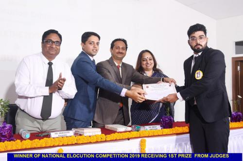 Winner of National Elocution Competition 2019 receiving 1st prize from the Judges